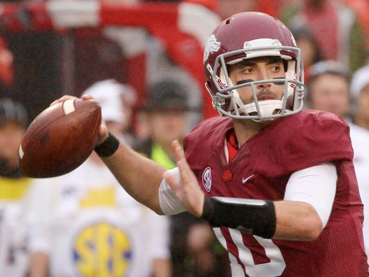 FILE - In this Oct. 11, 2014, file phot, Arkansas quarterback Brandon Allen passes in the first half of an NCAA college football game against Alabama in Fayetteville, Ark. The resurgent Razorbacks have enjoyed their relatively calm spring this year, which they'll cap with the Red-White game on Saturday, April 25. (AP Photo/Danny Johnston, File)