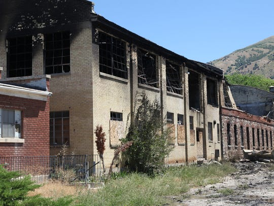 Fire crews from Brigham City, Utah look for spots at the the former Baron's Woolem Mill on June 30, after it was gutted by fire the previous night. A Porterville teenager who had been visiting family in the city reportedly has confessed to starting the fire.