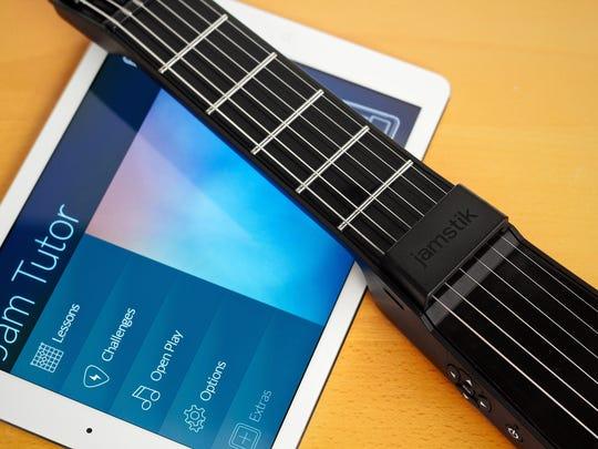"""With the help of an infrared light-sensing fretboard, jamstik provides real-time feedback to your iPad, iPhone or Mac, allowing you (for better or worse) to hear what you're """"playing."""""""