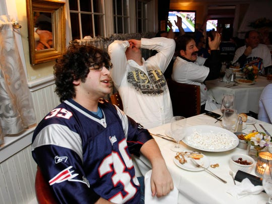 Patriots fan Jordan Levy from Chappaqua reacts to a play in the first half of the 2008 Super Bowl at Restaurant X in Congers. Festivities this year will start at 5 p.m. at Restaurant X and X2O Xaviars on the Hudson in Yonkers.