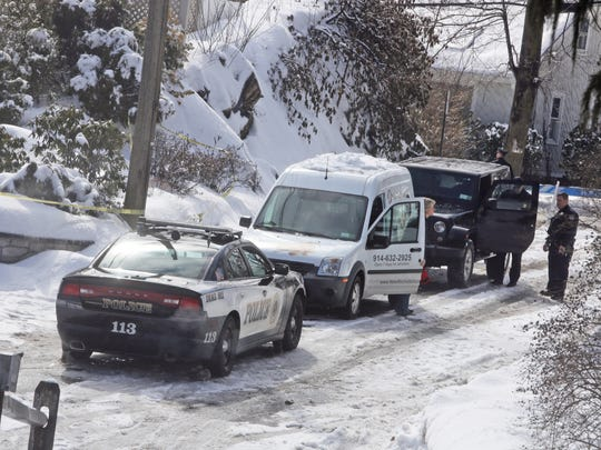 A New Rochelle humane society arrives 1 Adelphi Ave. in Harrison, photographed Feb. 22, 2015, a day after Glen Hochman, a retired White Plains police officer, killed two of his daughters before taking his own life. Hochman reportedly also killed the family's dogs.