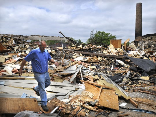 St. Cloud school district building and grounds supervisor Bryan Brown walks along the edge of the demolition work June 17, 2014, at the Roosevelt Education Center.