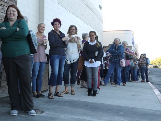 Customers wait for the store to open Monday at Hobby Lobby's grand opening.