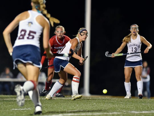 New Oxford's Carly Flickinger watches the ball she just passed against Bermudian Springs in the first half of the YAIAA field hockey title game Thursday, Oct. 19, 2017, at Northeastern. New Oxford won 1-0 to deliver Bermudian Springs their first season defeat and to win the Colonials' first field hockey championship.