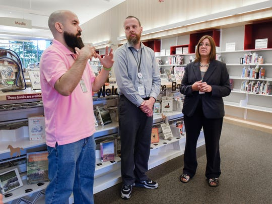 Eric Blotkamp, senior circulation assistant, Ryan McCormick, patron services supervisor and Karen Pundsack, executive director of Great River Regional Library, talk about library security Thursday, July 5, at the St. Cloud Public Library.
