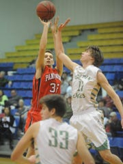 Norfork's Alex Disandro shoots a jumper over Greene County Tech's Landon Long during the Panthers' 52-43 loss at the 1st Arkansas Bail Bonds Tournament on Monday night.