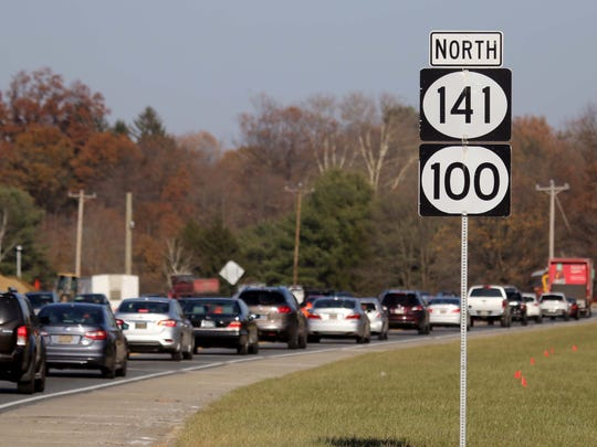 Traffic backs up in the northbound lane along Route 141 because the road has been narrowed down to two lanes for construction.