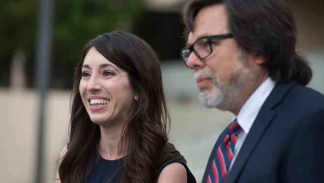 """Michelle Susan Hadley stands with her attorney, Michael Guisti, as they address the media after being cleared of all charges in a complicated plot to frame her in Fullerton, Calif., Monday, Jan. 9, 2017. Hadley has been exonerated of charges that she placed """"rape fantasy"""" ads on Craigslist in order to get men to attack her ex-boyfriend's new wife. Prosecutors now say that it was the alleged victim in the case who was trying to frame her husband's ex by placing the malicious ads."""