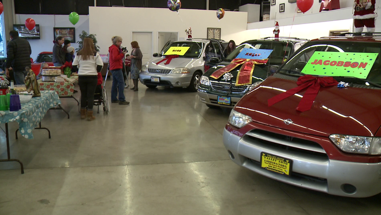 Three families surprised with a van filled with gifts