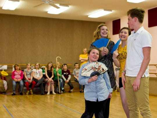Gaston (Andrew Cantley) is fawned over by a trio of girls (IsaBella Corn, Katelyn Haakenson, Courtney Tank) who can't understand why Belle isn't interested.