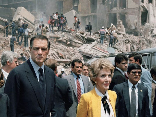 First lady Nancy Reagan and U.S. Ambassador to Mexico John Gavin, left, view earthquake damage in Mexico City in 1985.