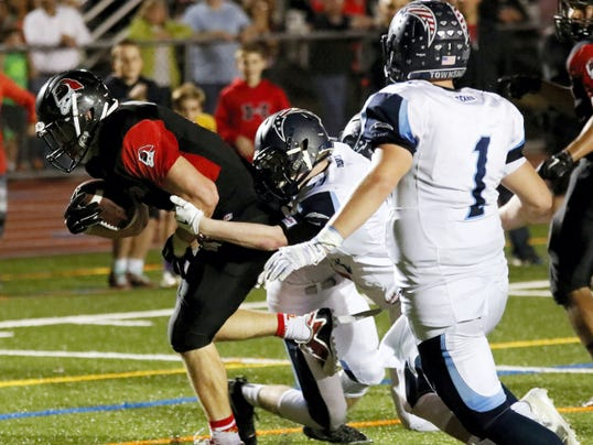 Hempfield's Will Blair drives his way into the end zone at Hempfield High School in Landisville on Friday.