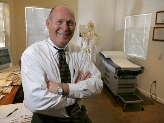 Doctors aren't that scarey. In fact, they can help you live a happier, healthier life -- if you take the time to talk with them. (AP Photo/John Storey)