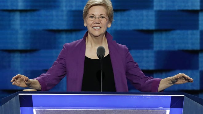 Sen. Elizabeth Warren, D-Mass, looks over the podium during a sound check before the kickoff of the Democratic National Convention in Philadelphia , Monday, July 25, 2016. (AP Photo/J. Scott Applewhite)