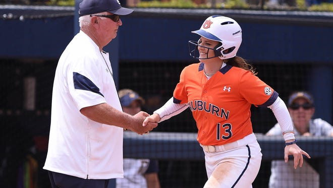Clint Myers shakes Kasey Cooper's (13) after her homerun.  Auburn vs Cal Golden Bears during the NCAA Regional final game on Sunday, May 21, 2017, in Auburn, Ala.