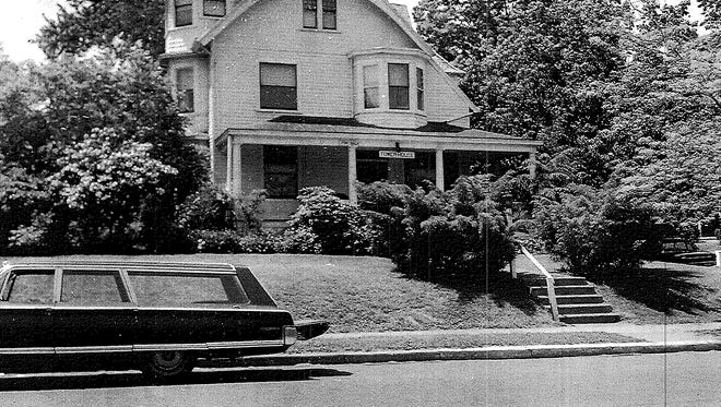 A funeral hearse outside 96 S. Broadway in South Nyack where  South Nyack-Grand View police found Florence Kalbach beaten, strangled and her throat slashed on May 24, 1973