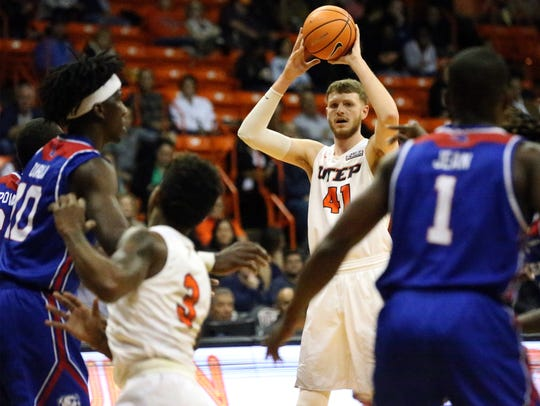 UTEP center Matt Willms looks for an outlet Thursday