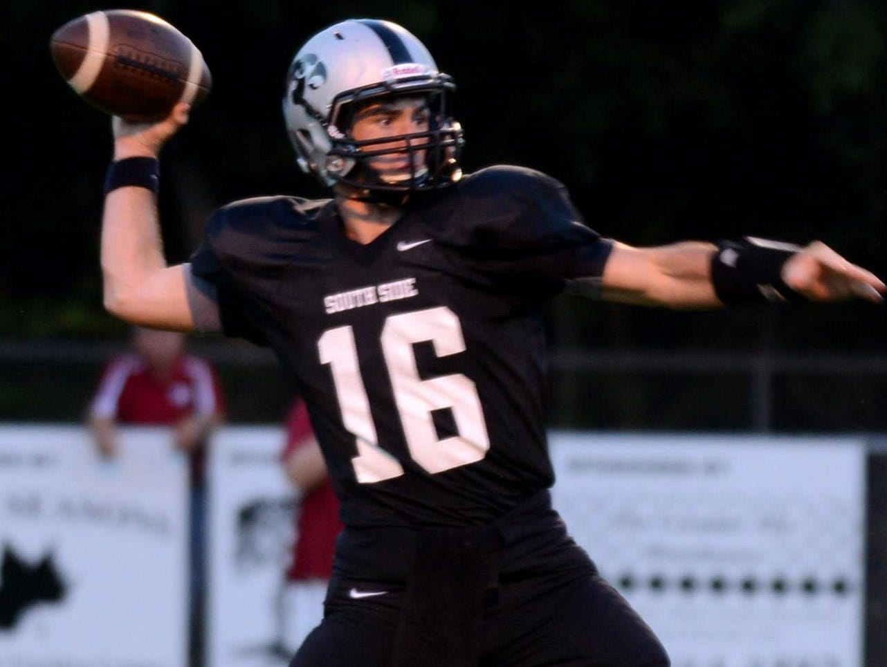 South Side's quarterback Cade Willingham throws a pass during a game last year. Willingham and the Hawks will not play rival North Side in a game that counts this year.