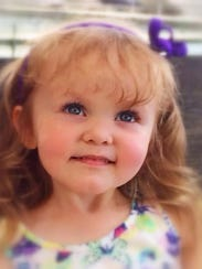 Ashley Vasey, the 3-year-old daughter of Mercy basketball