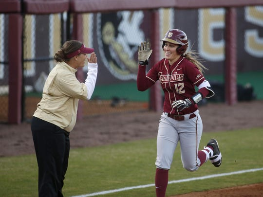 FSU's Carsyn Gordon gets a high five after hitting a grand slam in the first inning during their game against FAMU at Joanne Graf Softball Field on Wednesday.