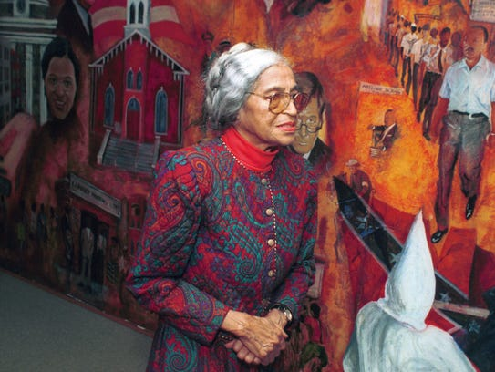 Rosa Parks walks by the civil rights mural at Dexter