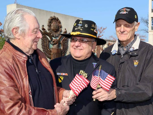 U.S. Army veteran Colin Stafford of Bloomfield Hills (left) shares a moment with Tim Strempka, who served with the highly-decorated 1st Cavalry Division in Vietnam, and Jim Suhay, a former U.S. Army Captain and West Point graduate who also served in Vietnam.
