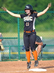 South Gibson's Aly Walker tries to fire up her teammates against Creek Wood in the Class AA state tournament.