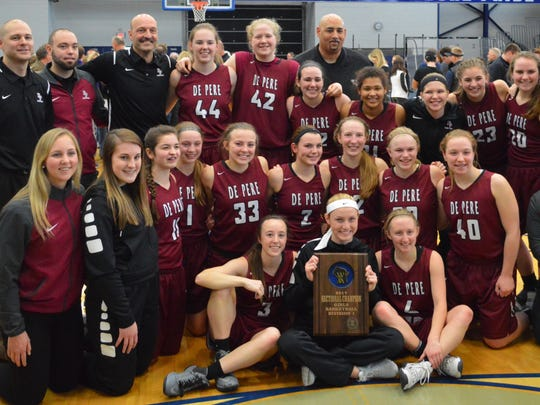 The De Pere girls basketball team defeated Germantown on Saturday to advance to the WIAA state tournament for the first time since 2012. Senior Lauren DeMille, holding the sectional championship plaque, has motivated the team during its state run after sustaining a season-ending knee injury in the second game.