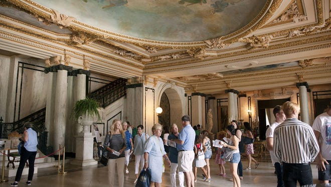 Visitors explore the grand hall during the Flagler Museum's annual Founder's Day event in 2019. The event allowed visitors to tour the first floor of the museum free of charge.
