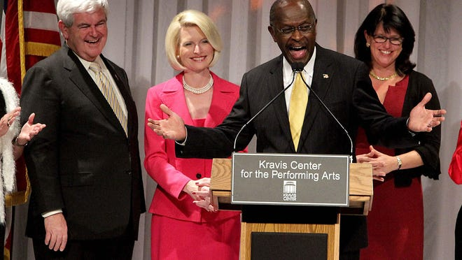 012812 (Thomas Cordy/The Palm Beach Post)---WEST PALM BEACH-- Newt Gingrich was officially endorsed by Herman Cain at the Lincoln Day Dinner at the Kravis Center in downtown West Palm Beach tonight, Saturday, January 28, 2012.