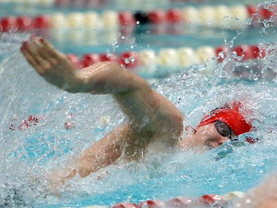 Waukesha South/Catholic Memorial's John Acevedo competes in the 200-yard freestyle at the WIAA Division 1 Boys State Swim Meet in the University of Wisconsin-Madison Natatorium on Saturday, Feb. 18, 2017, in Madison.