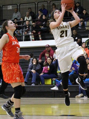 Alamogordo's Calysta Jacob, right, attempts a layup Friday night at the Tiger Pit.