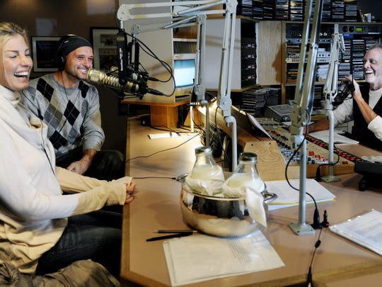 Faith Hill and Tim McGraw laugh while on the air with Gerry House Dec. 9, 2010.