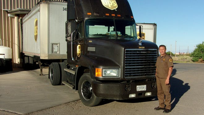 Alamogordo UPS Feeder Driver Gilbert Parra retired in April after 42 years of service. Parra is a Circle of Honor award winner. In stands next to his UPS tractor-trailer April 29.