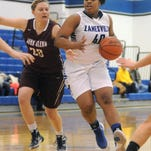 Zanesville's Devyn Bonner drives to the basket past John Glenn's Bre Tetirick during the Lady Devils 43-32 win over the Lady Muskies on Wednesday in Zanesville.