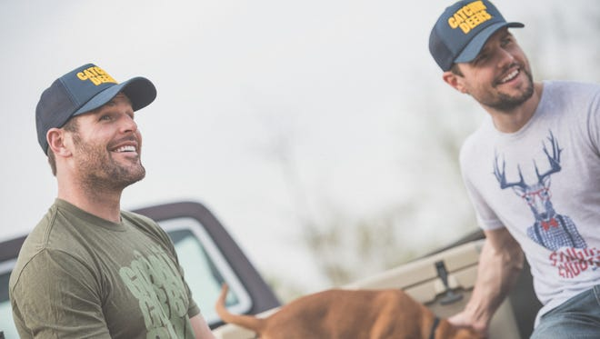 Predators forward Mike Fisher (left) and his younger brother Bud show off special-edition, blue-and-gold Catchin' Deers hats in support of the Nashville Predators playoff run.