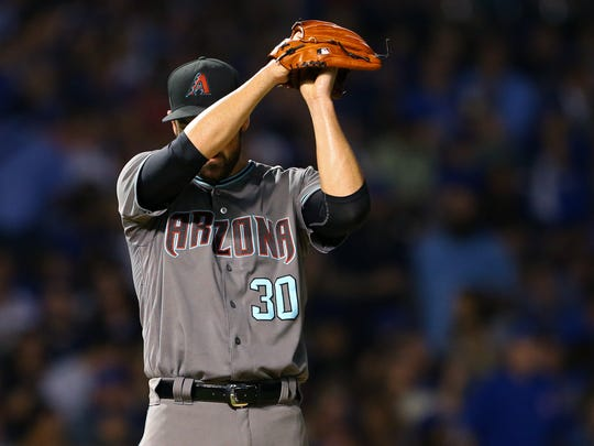 Diamondbacks reliever T.J. McFarland reacts between batters in the sixth inning of Arizona's 16-4 loss on Tuesday.