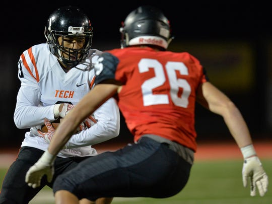 St. Cloud Tech's Brevyn Spann-Ford (3) looks for a
