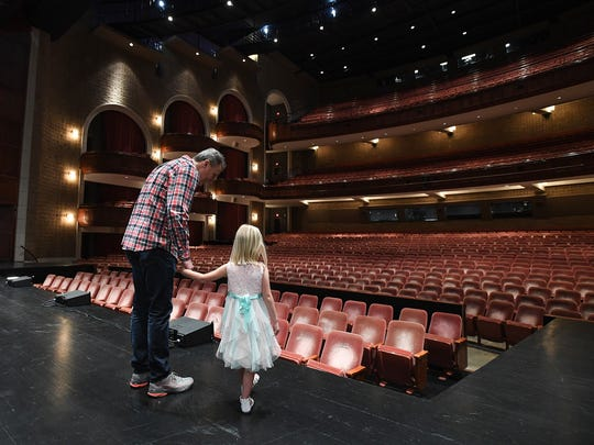 Regan Ciccarelli, 4, looks over the stage at the Peace Center with her father Dion on Wednesday, April 11, 2018 after being introduced as one of the two actresses cast as Lulu for the Greenville engagement of Waitress on May 8-13.