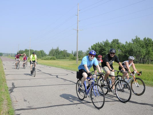 Pedalers unite on saintly tour