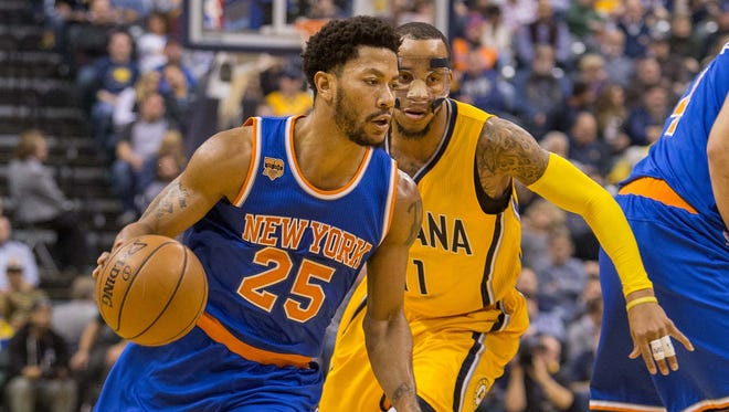 New York Knicks guard Derrick Rose (25) dribbles the ball while Indiana Pacers guard Monta Ellis (11) defends in the second quarter of the game at Bankers Life Fieldhouse.