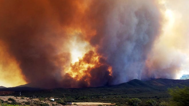 In this Tuesday, June 27, 2017, frame from video, flames and smoke rise from the Goodwin Fire near Mayer. The town, along with several other mountain communities in the area, evacuated.