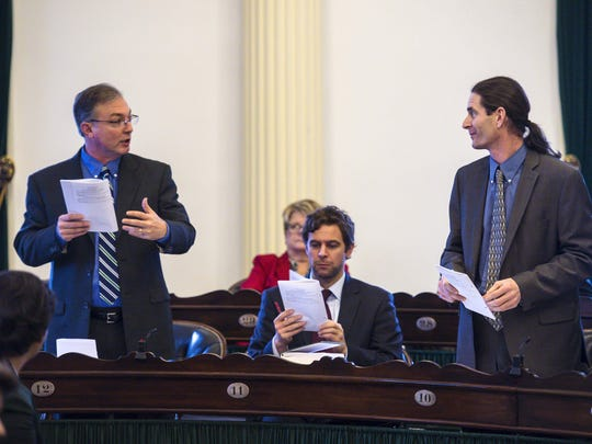 Sen. Philip Baruth, D-Chittenden, left, and Sen. David Zuckerman, P/D-Chittenden, discuss an amendment before the Senate gave its final approval to a marijuana legalization bill at the Statehouse in Montpelier on Thursday, February 25, 2016.