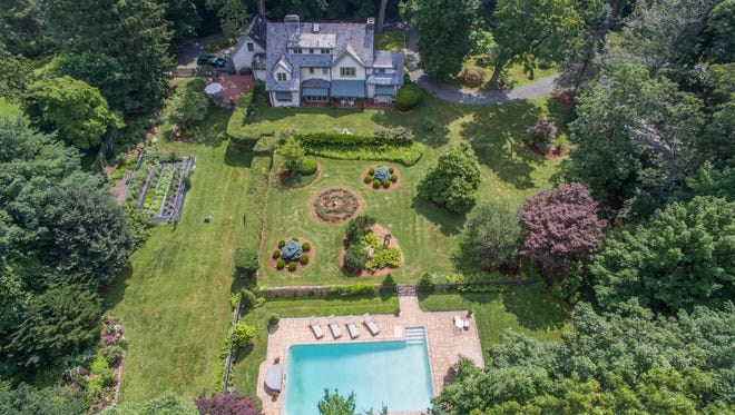 This turn-of-the-last-century estate home has been completely renovated, with an updated kitchen, five bedrooms, a wine room, a swimming pool, secret gardens and much more.