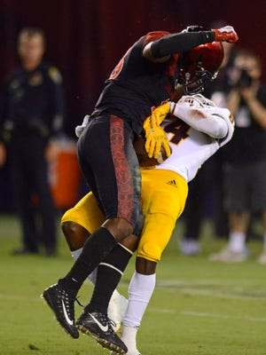 Sep 15, 2018; San Diego, CA, USA; San Diego State Aztecs safety Trenton Thompson (18) hits Arizona State Sun Devils wide receiver Frank Darby (84) during an incomplete pass during the fourth quarter at SDCCU Stadium. It was originally ruled a catch until a review overturned the call. Mandatory Credit: Jake Roth-USA TODAY Sports