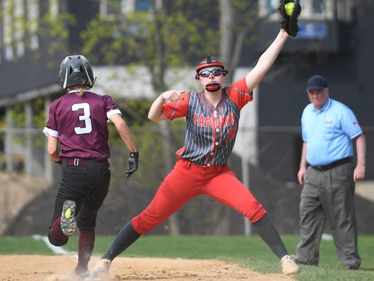 Coaches vs. Cancer Softball Tournament in Park Ridge. Ridgewood vs. Fair Lawn on Saturday, April 28, 2018. FL #18 Alyssa Gauthier gets the out at first.