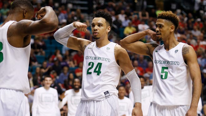 Oregon forward Elgin Cook, from left, forward Dillon Brooks and guard Tyler Dorsey react after a play against Washington during the second half of an NCAA college basketball game in the quarterfinal round of the Pac-12 men's tournament Thursday, March 10, 2016, in Las Vegas. Oregon won 83-77.