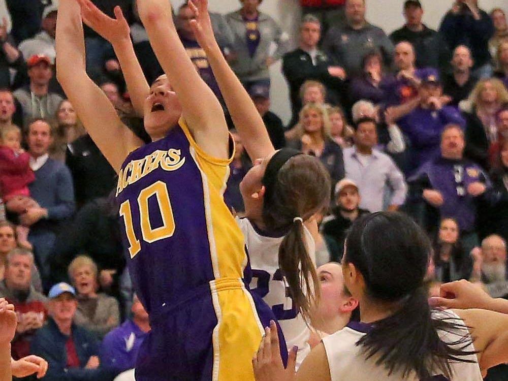 Cudahy's Hannah Kulas comes down with the rebound on a final shot attempt by New Berlin Eisenhower in a WIAA Division 2 sectional semifinal, won by Cudahy 47-45.