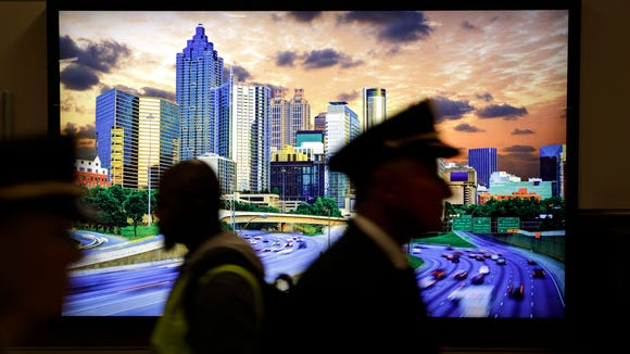 An image of the downtown skyline hangs in Hartsfield-Jackson