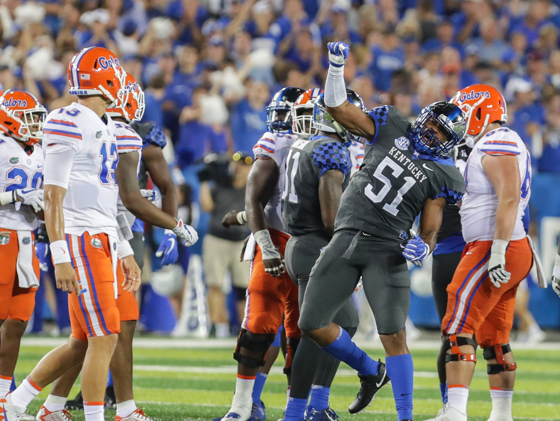 Kentucky's Courtney Love celebrates after a big tackle.